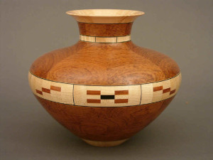 Vase of bubinga (an African wood), maple, and ebony.  Ten inches tall.